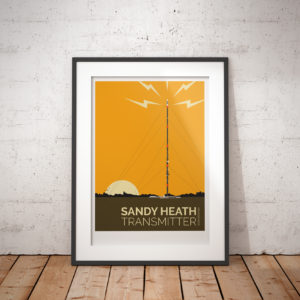 A photo of a framed copy of my modern travel poster of Sandy Heath transmitting station, a television broadcast station located between the towns of Sandy and Potton, Bedfordshire.