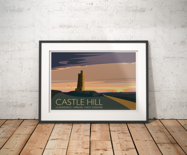 A photo of a framed copy of my modern travel poster of Castle Hill, a scheduled ancient monument in Almondbury overlooking Huddersfield in the Metropolitan Borough of Kirklees, West Yorkshire, England.