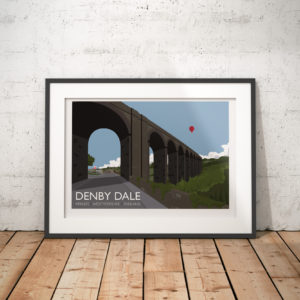A photo of a framed copy of my modern travel poster of the Penistone Viaduct, a is curved railway viaduct carrying the the Penistone Line over Wakefield Road, Barnsley Road, and the River Dearne, in the village of Denby Dale.