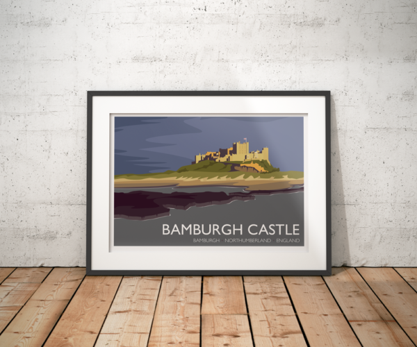 A photo of a framed copy of my modern travel poster of Bamburgh Castle, a Grade I listed castle on the northeast coast of England.