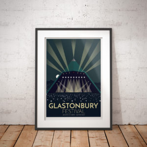 A photo of a framed copy of my modern travel poster of the world famous Glastonbury Festival, a five-day festival of contemporary performing arts that takes place near Pilton, Somerset, England.