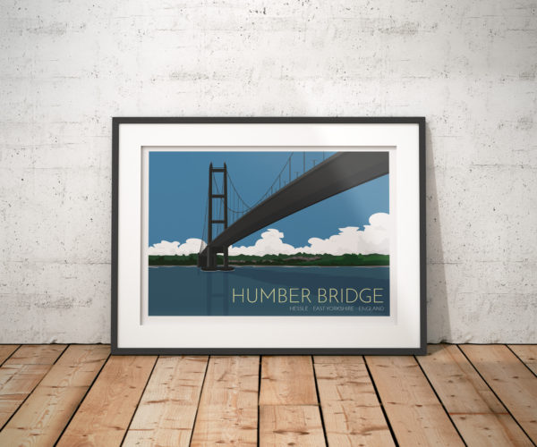 A photo of a framed copy of my modern travel poster of the Humber Bridge, near Kingston upon Hull, East Riding of Yorkshire, England, a 2. 22-kilometre single-span road suspension bridge, which opened to traffic on 24 June 1981.