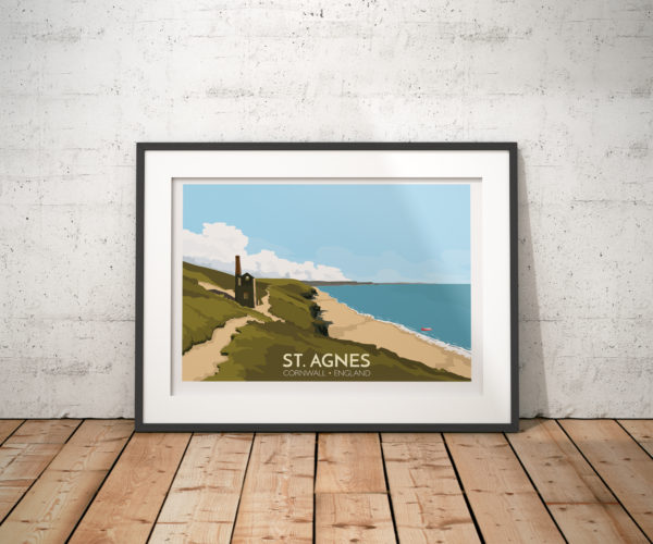 A photo of a framed copy of my modern travel poster of the ruined Wheal Coates tin mine, near St Agnes on the North Cornwall coast.