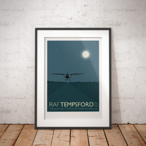A photo of a framed copy of my modern travel poster of a Westland Lysander taking off by moonlight from RAF Tempsford, Bedfordshire.