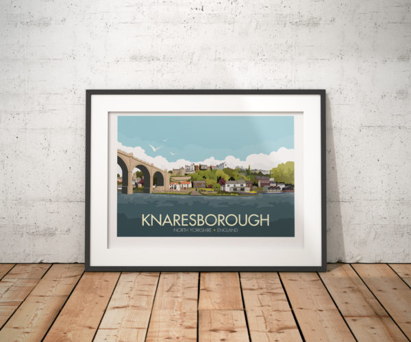 A photo of a framed copy of my modern travel poster of Knaresborough, a market and spa town near Harrogate, North Yorkshire, England.