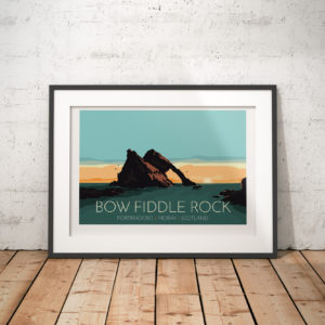 A photo of a framed copy of my modern travel poster of Bow Fiddle Rock, a natural sea arch near Portknockie on the north-eastern coast of Scotland.