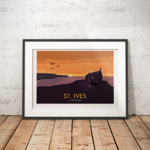 A photo of a framed copy of my modern travel poster of the sun setting over St Nicholas Chapel in St Ives, Cornwall.