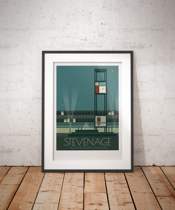 A photo of a framed copy of my modern travel poster of the clock tower and fountains in the town square in Stevenage, Hertfordshire.