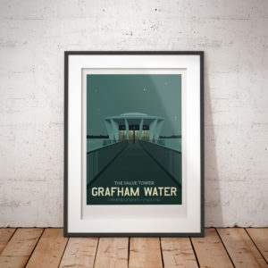 A photo of a framed copy of my modern travel poster of the valve tower at Grafham Water reservoir, Southwest of Huntingdon in Cambridgeshire. Like the lair of a James Bond villain, it looks awesome in the moonlight.