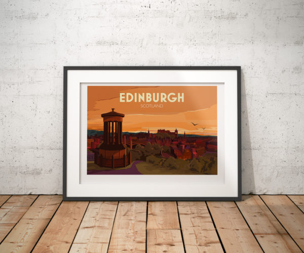 A photo of a framed copy of my modern travel poster of the glorious Edinburgh skyline at sunset. This is the view looking down from Calton Hill, with the castle, numerous church spires, Waverley Bridge and the station in the distance.