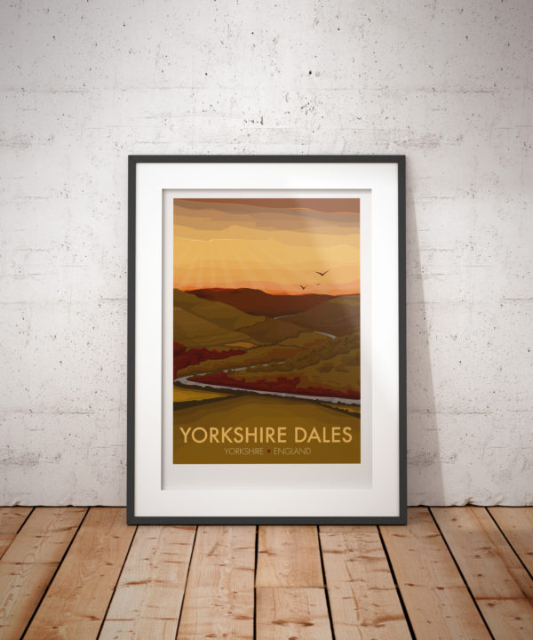 A photo of a framed copy of my modern travel poster of the drystone walls, moorlands, steep hills and lush valleys that make up the Yorkshire Dales. .