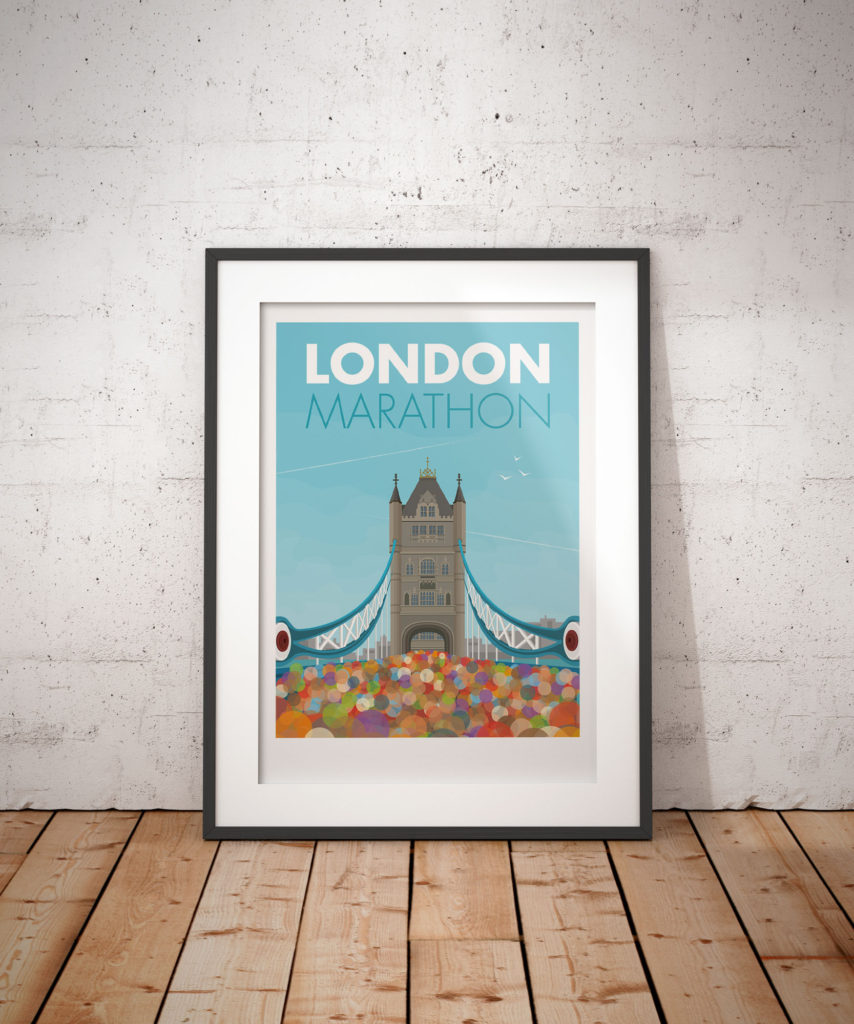 A photo of a framed copy of my modern travel poster of thousands of people crossing the River Thames at Tower Bridge in London, taking part in the London Marathon.