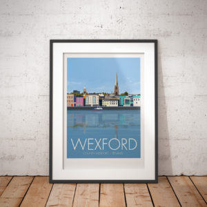 A photo of a framed copy of my modern travel poster of the waterfront in Wexford, on the East coast of the Republic of Ireland.