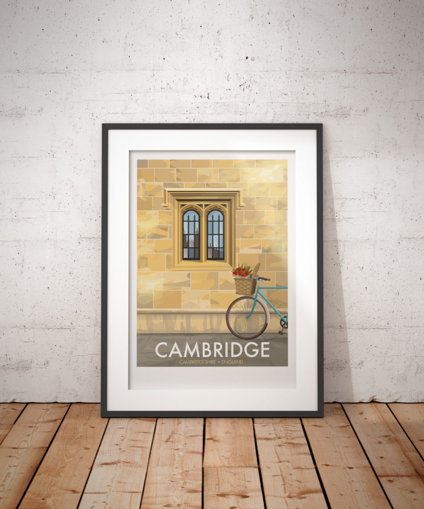 A photo of a framed copy of my modern travel poster of the university city of Cambridge, with its iconic stone walls, and Kings College reflected in the window.