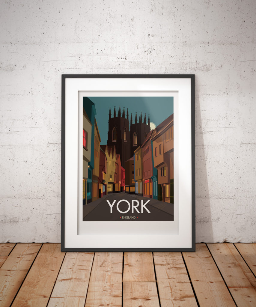 A photo of a framed copy of my modern travel poster of Low Petergate and York Minster, in the beautiful city of York, England.