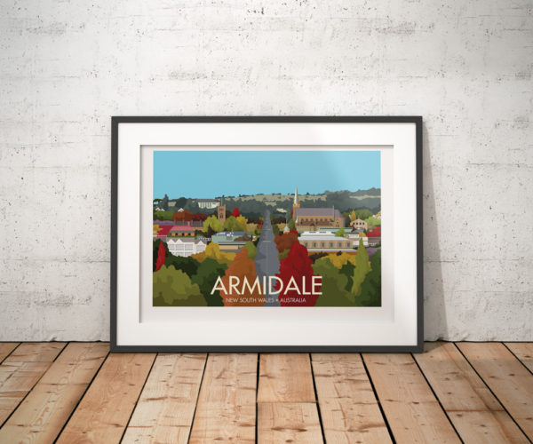 A photo of a framed copy of my modern travel poster of Armidale, a city in New South Wales, Australia.