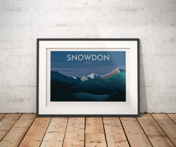 A photo of a framed copy of my modern travel poster of Mount Snowdon in the heart of Snowdonia in Wales viewed from the Miners track.