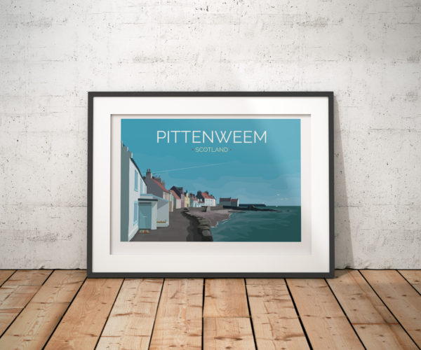 A photo of a framed copy of my modern travel poster of Pittenweem, a beautiful fishing village in Fife, on the east coast of Scotland.